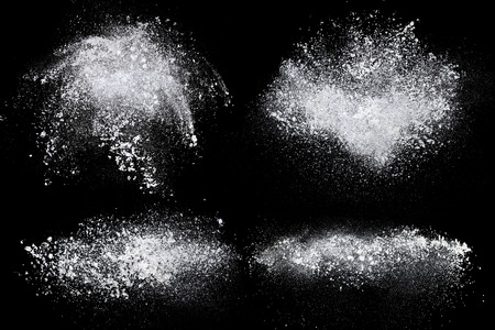 Set of dust powder splash clouds isolated on black background