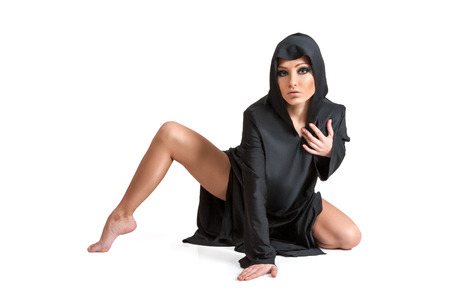 sexy costume: Young woman in the black mantle isolated on white background Stock Photo
