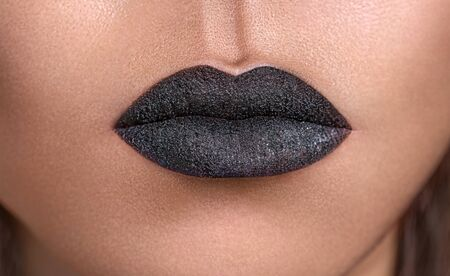 macros: Closeup photo of lips with fashion black make up Stock Photo
