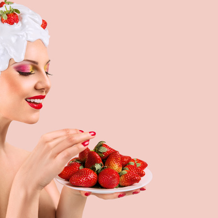 ripeness: Young woman with hairstyle made from milk and strawberry eating red ripe berries