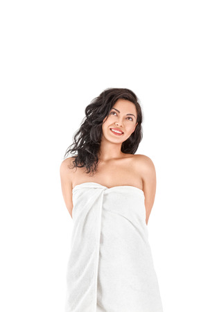 white towel: Beautiful young asian woman with perfect skin wrapped in towel isolated on white background Stock Photo