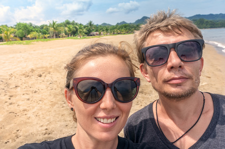 Man and woman traveling together to asian tropical islands doing selfie photo Stock Photo