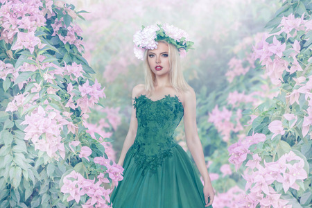 Young sexy woman in magic blossom forest