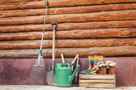 sheds: Set of gardening tools near of old rustic wooden wall Stock Photo