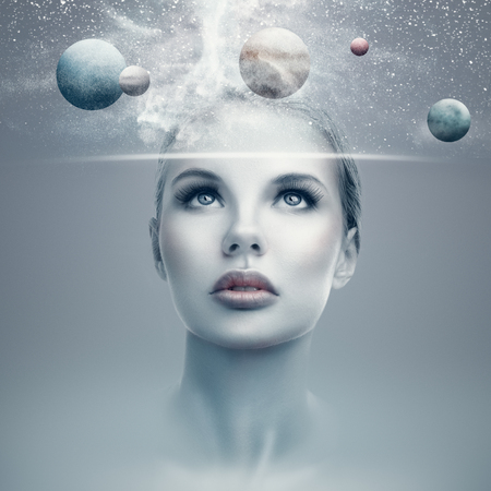 Futuristic portrait of young woman with virtual hologram display showing space and planets