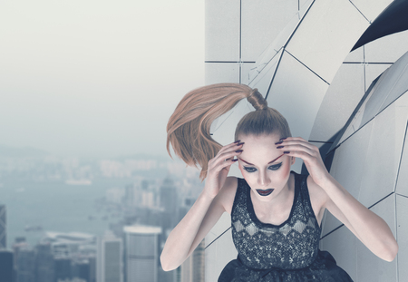 Serious fashion model posing on skyscraper rooftop 版權商用圖片