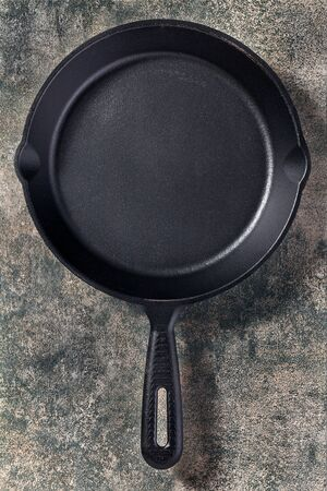 Abstract frying pan background on stone surface