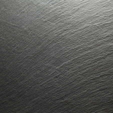 Abstract closeup of natural black stone background