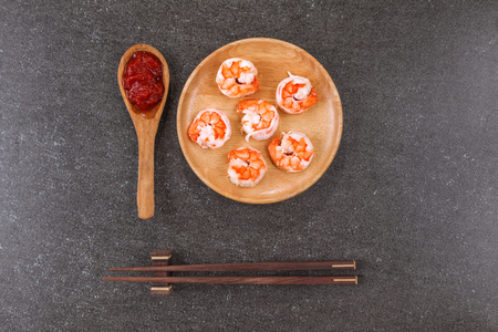 spice: Roasted shrimps served plate with hot sauce. View from above