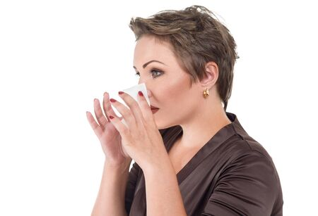 Young sick woman blowing her nose suffers cold and flu or allergy
