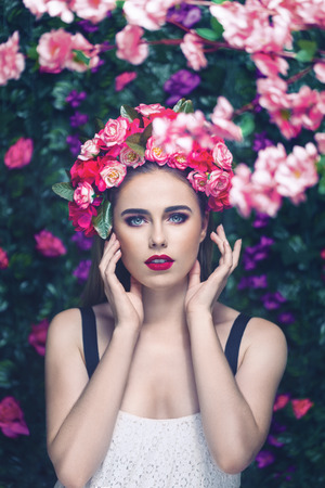 Beautiful young woman beauty and fashion portrait in flowers garden