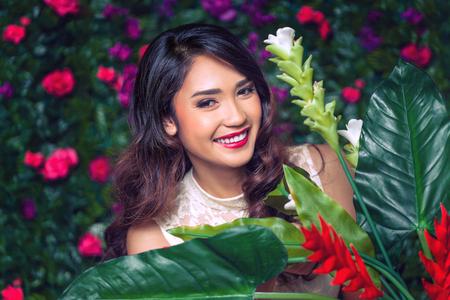 Beautiful young asian woman beauty and fashion portrait in flowers garden