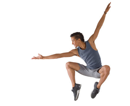 Young man jumping isolated on white background. Dance performer Stockfoto