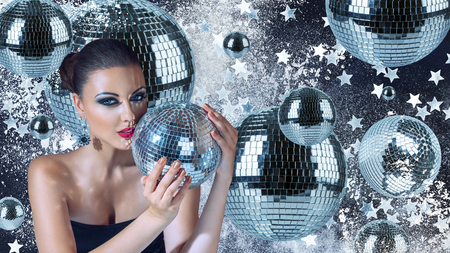 Young attractive woman with disco balls night club portrait Stock Photo