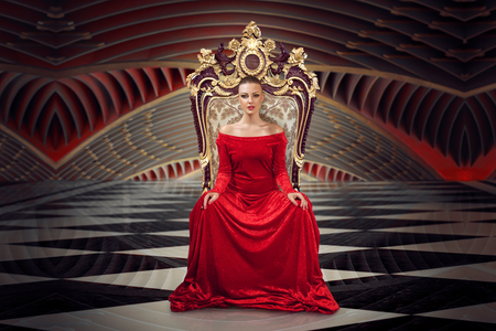A woman in a luxurious gown dress sitting on a queen's throne 写真素材 - 104193087