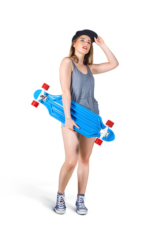 Portrait of young woman with skateboard isolated on white background Stockfoto