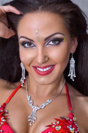 Close up portrait of young woman belly dance performer in exotic costume