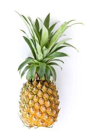 Fresh whole ripe pineapple isolated on white background
