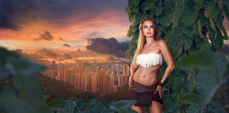Fashion portrait of Young beautiful woman in tropical jungle outside of modern city. Escape from urban life back to wild nature.