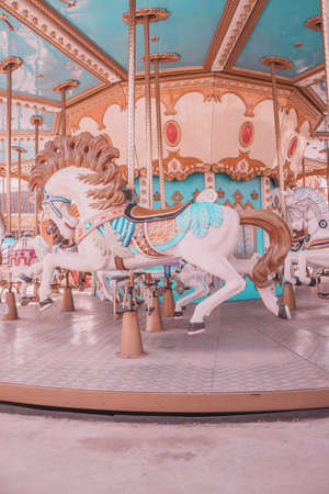 Vintage style empty carousel horse at playground 新聞圖片
