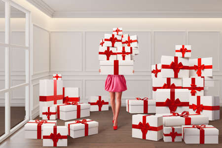 Sale concept with young woman holding many gift boxes