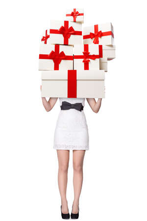Sale concept with young woman holding many gift boxes isolated on white background 版權商用圖片