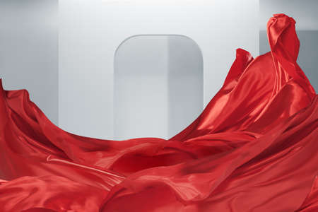 Fluttering red silk textile clothes  isolated over abstract white architectural background. Abstract Design elements