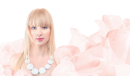 Portrait of young beautiful woman with dress made from pink flowers petals isolated on white background 版權商用圖片