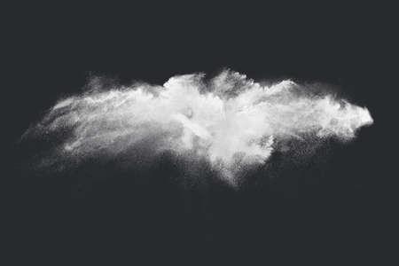 Abstract design of white powder snow cloud explosion on dark background 版權商用圖片
