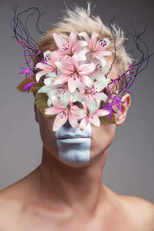 Abstract contemporary art collage portrait of young man with flowers bouquet over face