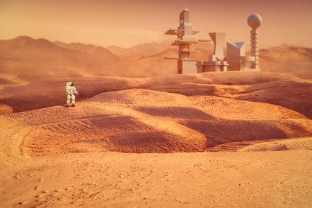 Astronaut exploring Mars planet in front of futuristic buildings. 版權商用圖片