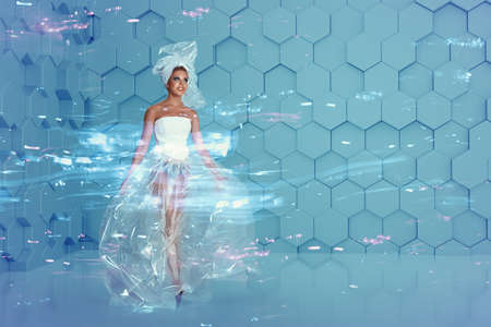 Futuristic fashion portrait of young holographic woman on abstract background