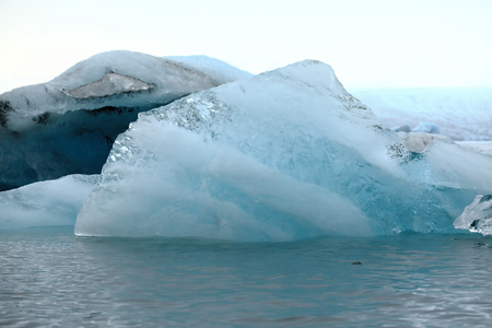 Icebergs on an Iceland glacier, blue, white and transparent ice
