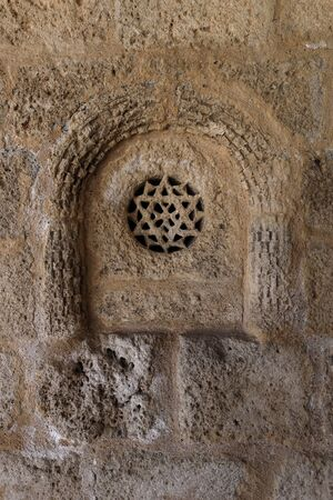 Change rosette in the Romanesque church of San Bartolom?. Campis?balos (Guadalajara, Spain)