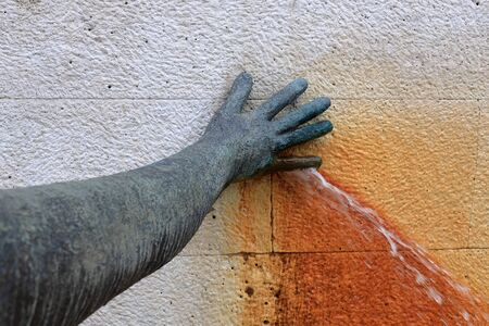 Hand plugging a water leak
