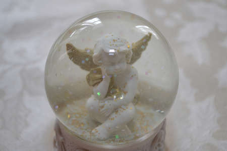 Angel in crystal ball