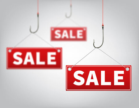hangs: Three red tags of sales, which hangs on a hooks