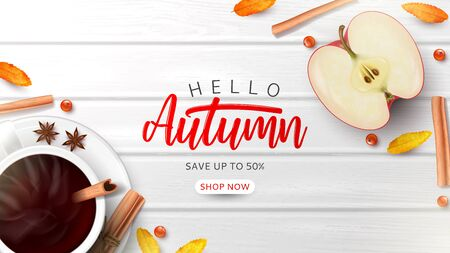 Autumn sale ads banner template. Top view on composition with coffee cup, sliced apple, rowan berries and leaves and cinnamon sticks on wooden texture.