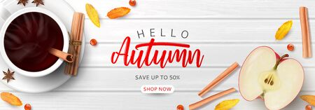 Promo banner template for autumn sale. Top view on composition with coffee cup, sliced apple, rowan berries and leaves and cinnamon sticks on wooden texture.