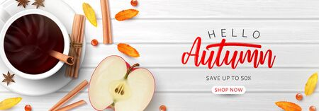 Web banner template for autumn sale. Top view on composition with coffee cup, sliced apple, rowan berries and leaves and cinnamon sticks on wooden texture.
