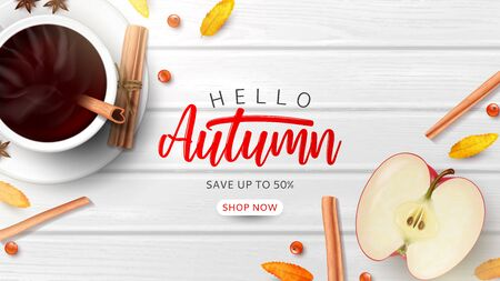 Autumn sale promo banner template. Top view on composition with coffee cup, sliced apple, rowan berries and leaves and cinnamon sticks on wooden texture.