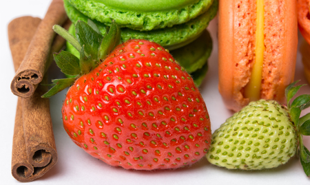 juicy: colorful juicy fruits and macaroons Stock Photo