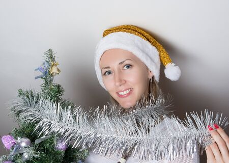 the tinsel: snow maiden with Christmas tinsel Stock Photo