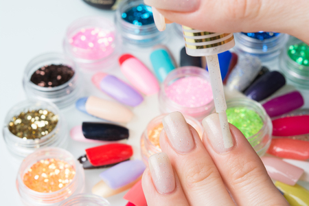 shellac: application to the nails girls Stock Photo