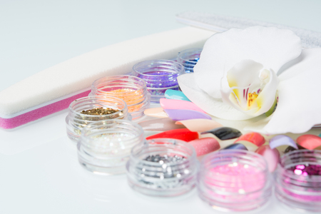 shellac: manicure set with an Orchid on the glass table Stock Photo