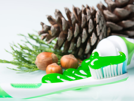 toothbrush with a bright green paste
