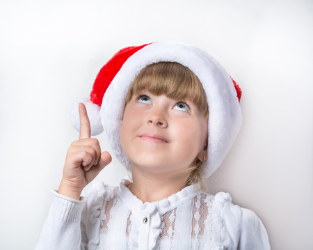 young maiden in a red cap Stock Photo