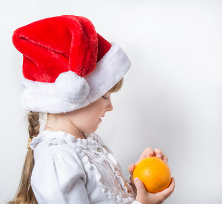 snow maiden: child, little girl, snow maiden, holiday, new year, Christmas, red hat, winter, symbol, greetings, emotions, mood, white background, blue eyes, smile, portrait, person, kid, female, happiness, happy, bright, gift, xmas, santa, laughter, decoration, magic, Stock Photo