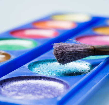 lint: set of bright watercolors with brush