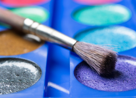 lint: set of watercolors with brush